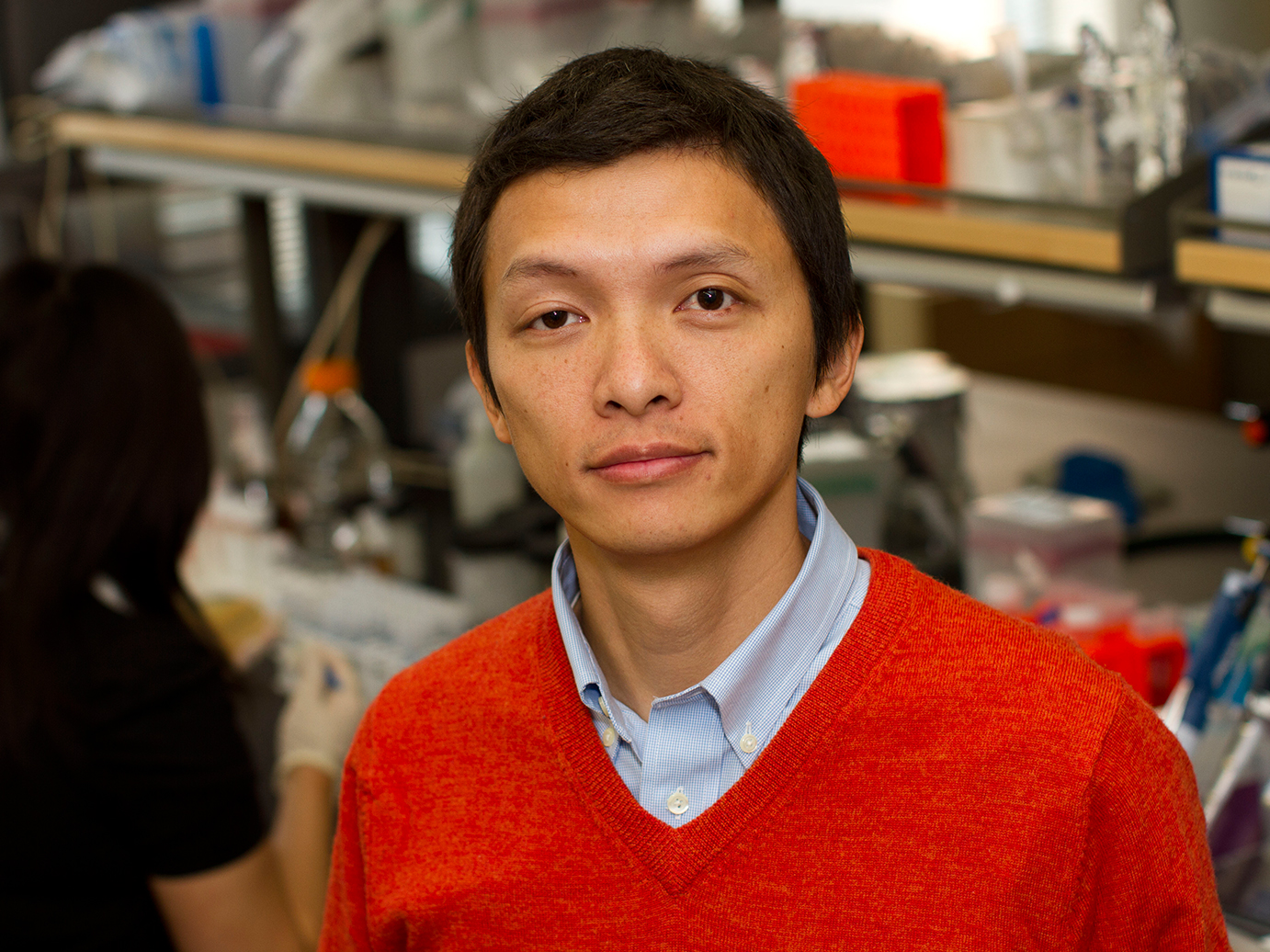 Portrait: Xiao Wang, standing in his lab